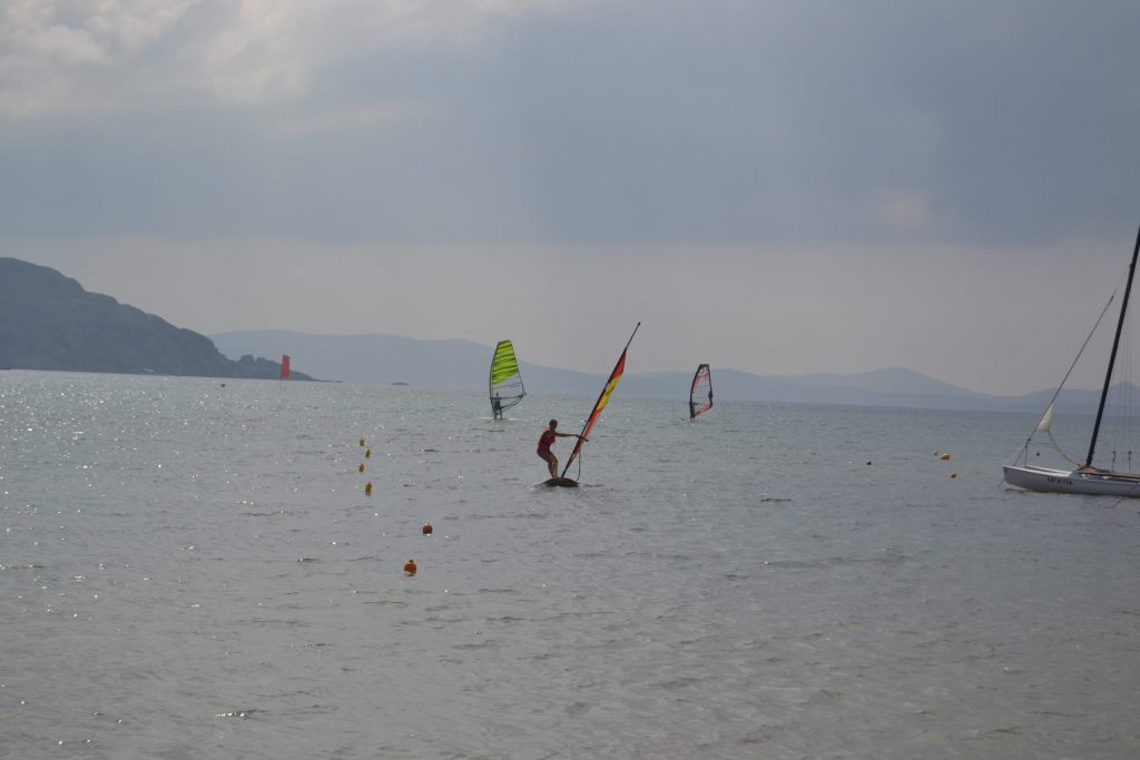 Lina trying a free windsurfing lesson in Naxos